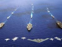 B-2 隐形轰炸机 与 F-18 航空母舰 编队飞行